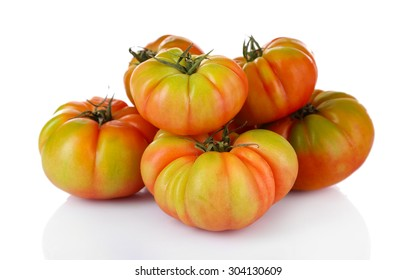 Green tomatoes isolated on white