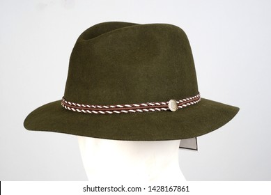 green tone male trilby hat lifeless mannequin stands on his head grey background male fashions accessory buy hat buying.