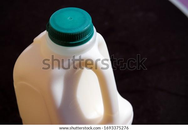 Green top milk plastic bottle