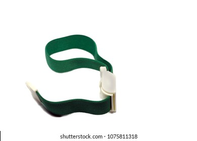 Green tourniquet band on a white background. Tourniquet as a handy tool for constricting blood vessels and veins fir IV medical manipulation