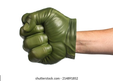 Green toy fist on a white background
