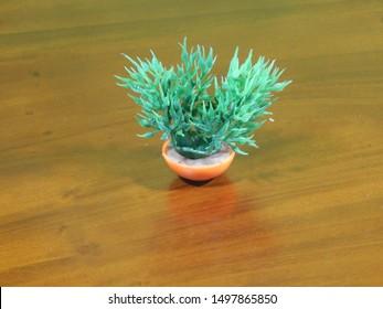 Green Toy Grass with an Orange Vase