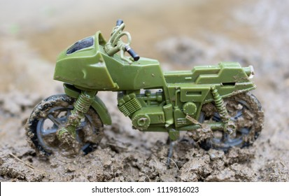 Green Toy Motorcycle In Mudd