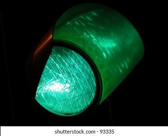 Green traffic light by night