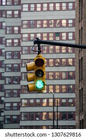 A green traffic light on a interception in down town Manhattan in New York city