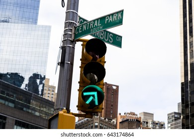 Green traffic light on the intersection of Central Park South and Colombus Circus