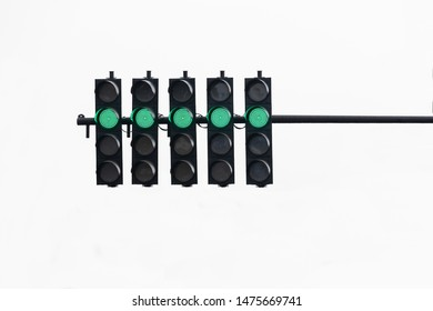 Green traffic light on white isolated background.