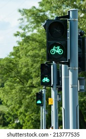 Green traffic lights for bicycles in a row.