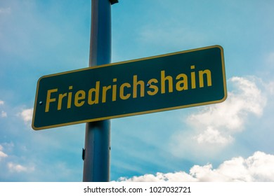 green traffic sign of district friedrichshain at berlin