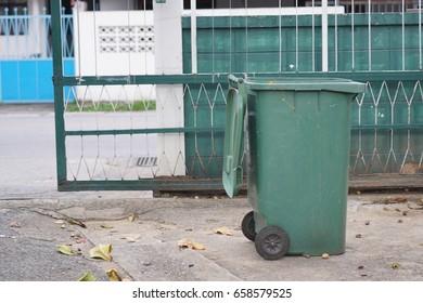 Green trash bin near the gate park in Thailand