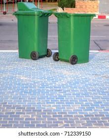 Green trash on the street