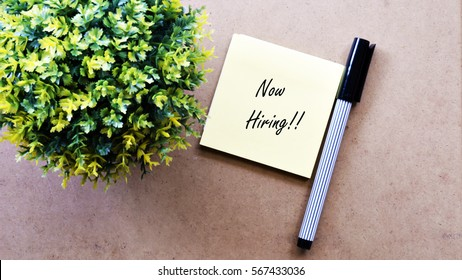 Green tree, sticky note with text Now Hiring