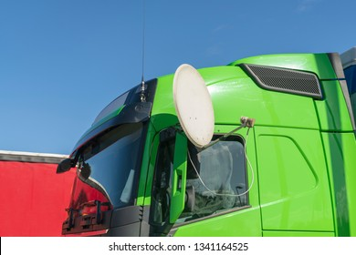 Green truck with satellite dish