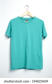 Green tshirt template on hanger ready for your own graphics.