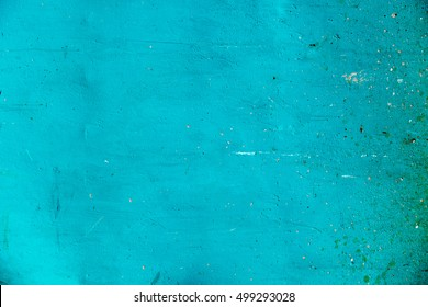 Green turquoise wall background with rough texture and dirt