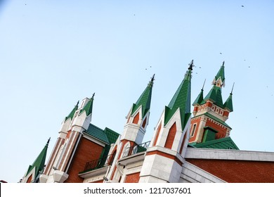 Green turrets on the roof against the sky. Oblique photography. The oblique composition