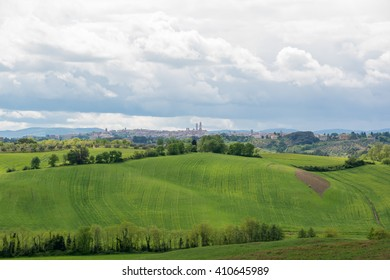green Tuscan countryside in the spring in the province of Siena Italy