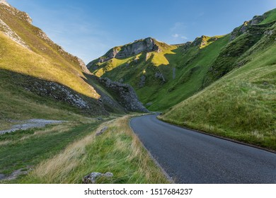 Green valley with mountain road, Winnats Pass, Hope Valley, Peak District,  England