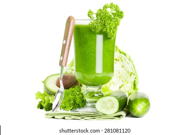 Green vegetable smoothie juice isolated on white background