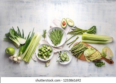 Green vegetables for healthy cooking. Vegetarian and vegan food. Healthy diet eating concept. Top view, flat lay with copy space