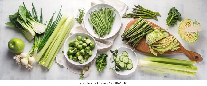 Green vegetables for healthy cooking. Vegetarian and vegan food. Healthy diet eating concept. Top view, flat lay. Panorama, banner