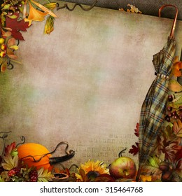 Green vintage background with umbrella autumn leaves and pumpkin
