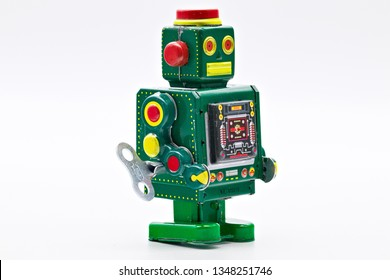 Green vintage old wind up toy robot isolated on white limbo background