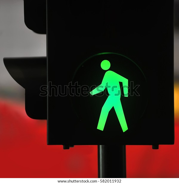 Green walk sign at a traffic light. safe to move ( Pedestrian Traffic Lights )
