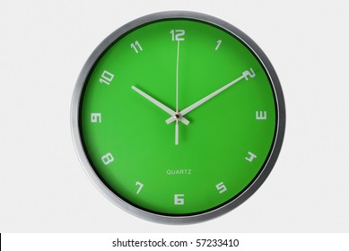 Green wall clock isolated with clipping path