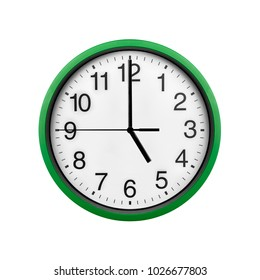 Green wall clock isolated on white background. Five o'clock.