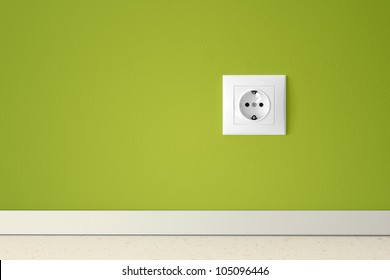 Green wall with european electric outlet.Conceptual.