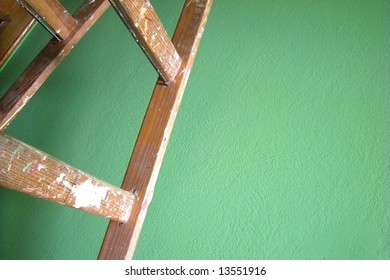Green wall and ladder
