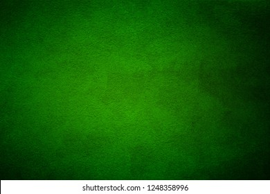 Green wall texture for designer background. Artistic plaster. Rough lighted surface. Abstract pattern. Bright backdrop. Raster image.