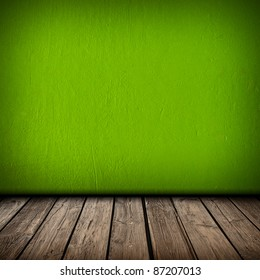 Green wall and wooden floor interior background