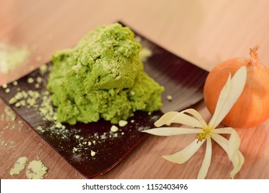 Green wasabi fresh on a wooden tray