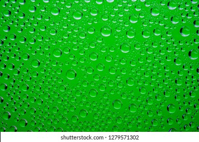 Green water drops background close up.
