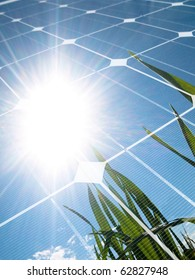Green wheat  field against the sun with photovoltaic panel
