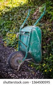 Green wheelbarrow in garden