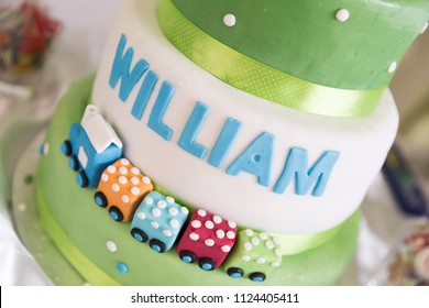 Green and White Birthday Cake with Train Decoration