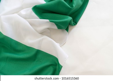 green white Nigerian National flag on right side isolated on white surface