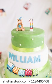 Green and White One Year Old Birthday Cake and Candle