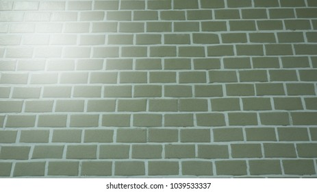 green and white pattern brick wall building with sunray