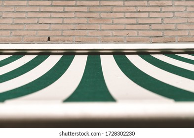 Green and white window sun shade sail