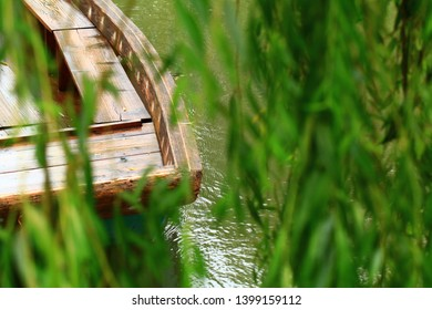 The green willow tree and  the boat