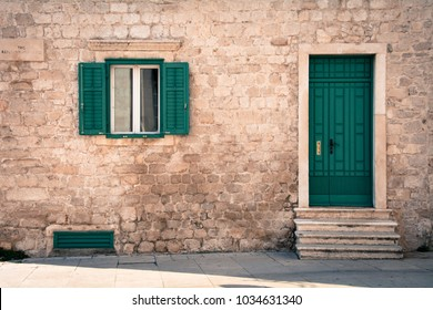 Green window and green door on old traditional house in Sibenik Croatia