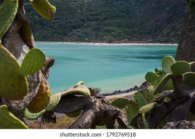 Green window on landscape of turquoise Lake Venere in Pantelleria. A Mediterranean island in Sicily. Italy.