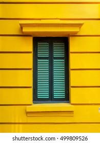 The Green Window In Yellow wall