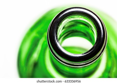 Green wine bottle top view of the neck with shallow depth of field.