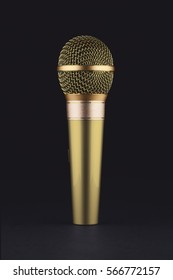 A green wireless microphone on a black background