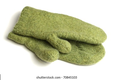 Green wollen knitted mittens over white background